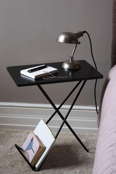 Tiny is a side table and a magazine stand in one and the same furniture. Suits all rooms and comes in black and white.