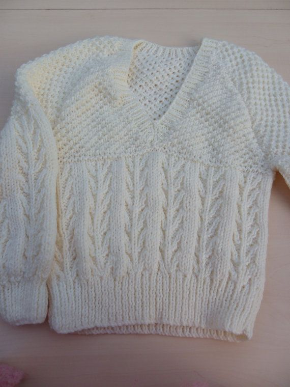 Hand knitted childrens aran jumper hat and mittens set - childrens clothing - knitwear - winter clothes - woolly hat  What better way to keep warm than with this lovely cream hand knitted aran jumper, hat and mittens set. All have a lovely aran textured pattern. The jumper is long sleeved and has a v neckline and the hat is a traditional beanie style with a turn up brim.  The jumper is to fit 24 inch (61cm) chest which is about 3 - 4 years Jumper measurements when laid flat Chest 14 inches…