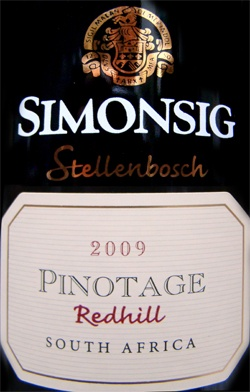 """Simonsig """"Redhill"""" Pinotage 2009 via winemaker: """"Dense opaque colour.  A tapestry of dark luscious fruit . Effortless expression of intense notes of plum and mulberry. A thread of cinnamon spice and vanilla pod adds dimension to this tapestry. Tightly knitted yet smooth tannins sculpture a lingering palate of fruit filled delicacies."""""""