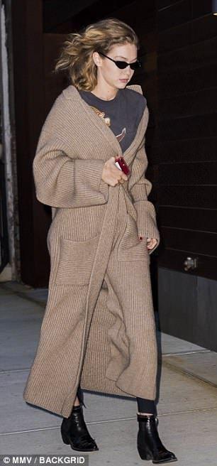 80abda5b06 Gigi Hadid wraps up in brown maxi cardigan in NYC after Coachella