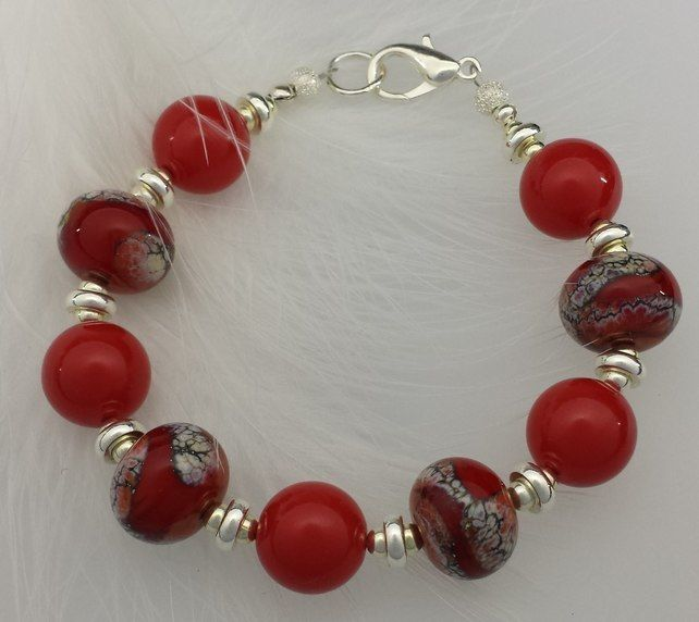 Red beaded bracelet with lobster clasp £20.00