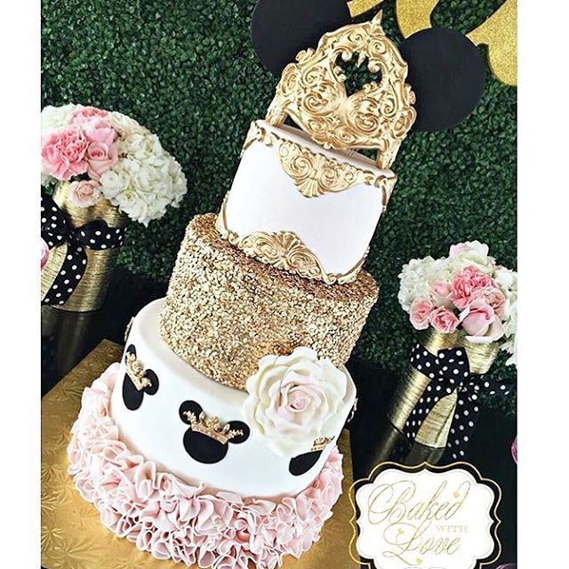 Pink and gold Minnie Mouse birthday party elaborate cake idea. For more ideas, follow A Pop of Party!
