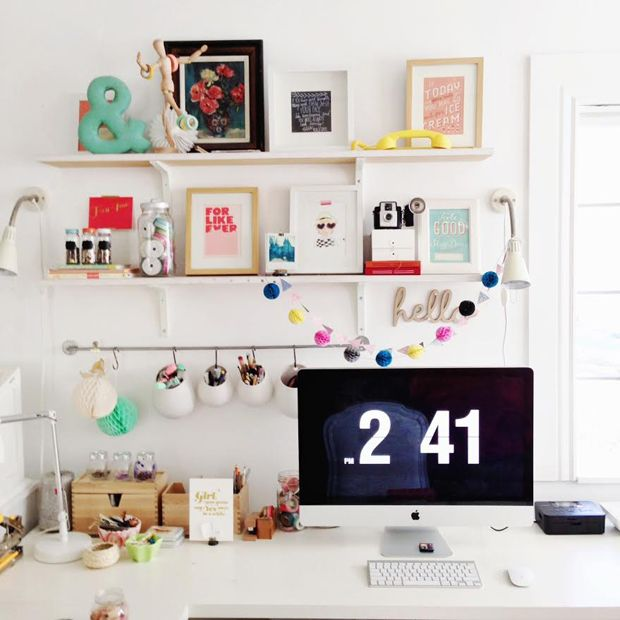 Bright work space with beautiful prints