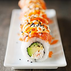 Volcano roll: crab, avocado, cucumber roll topped with spicy tuna, masago, sriracha mayo and wasabi mayo.