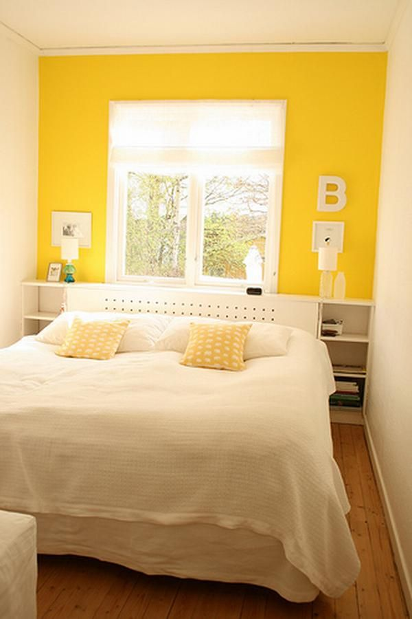 Yellow feature wall; Wooden floor
