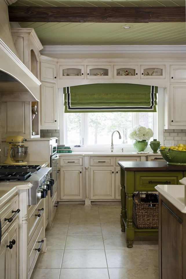 ...adore this kitchen...green finish on island and matching roman shade...lovely!