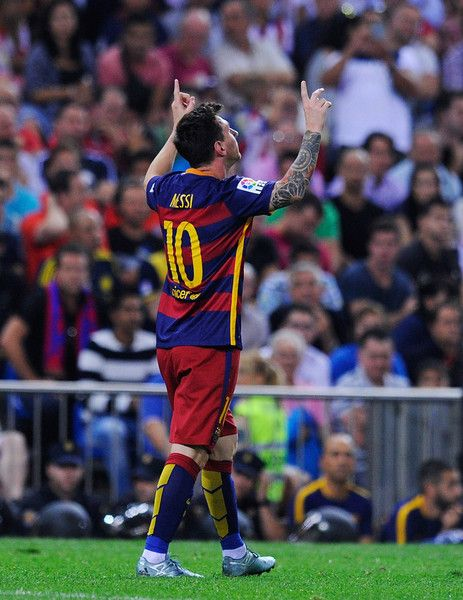 Lionel Messi of FC Barcelona celebrates after scoring his team's 2nd goal goal during the La Liga match between Club Atletico de Madrid and FC Barcelona at Vicente Calderon Stadium on September 12, 2015 in Madrid, Spain.