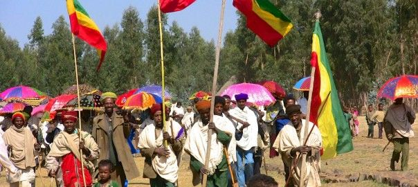 The community at Mequat Mariam parade the Tabot out at TImkat with Ethiopian flags flying