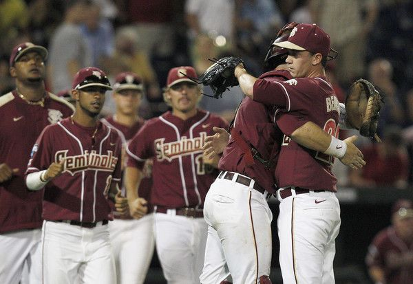 Florida State Seminoles catcher Stephen McGee (9) hugs Robert Benincasa (22) after defeating the UCLA Bruins in game nine of the 2012 College World Series at TD Ameritrade Park. Florida State won 4-1.
