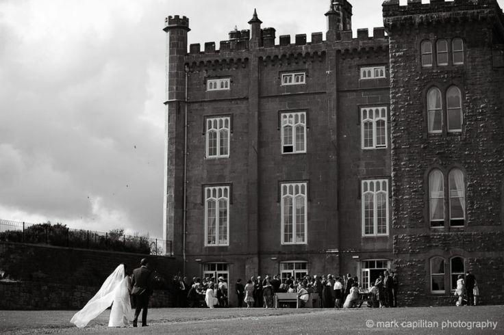 Bride & groom walking in black & white Kilronan Castle Ireland wedding photographer sligo