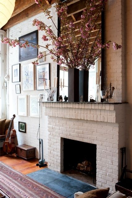 painted brick fireplace in a converted loft