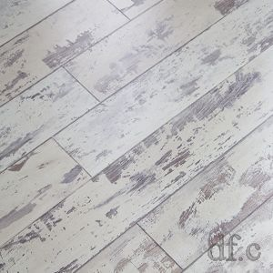 Love this! It looks like old chippy painted flooring but it's tongue & groove laminate flooring.  It's easy to install and wouldn't show dirt like solid colored flooring.  This would add so much character to a room!
