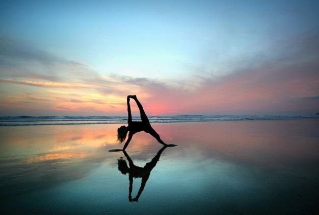 World-renowned yoga teacher Shiva Rea captured at low tide at sunset on the expansive beach in Nosara, Costa Rica.