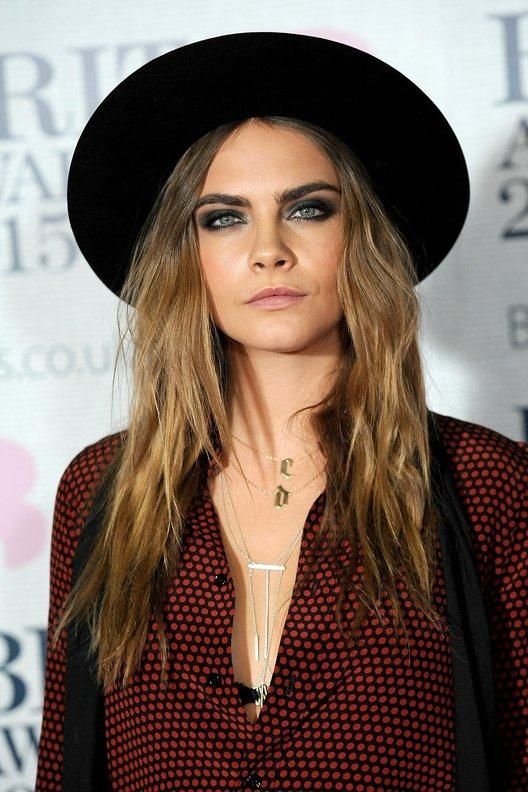Cara Delevingne's Evolution & Best Red Carpet Beauty Moments | February 2015