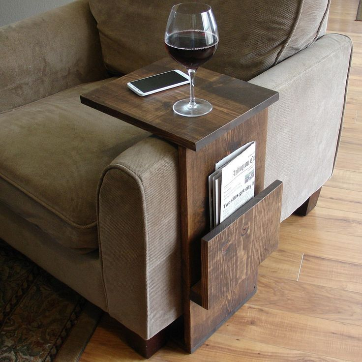 Handcrafted tray table stand with side storage slot. The perfect addition to a sofa chair in any home, apartment, condo, or man cave.  It has been sanded down, then stained and sealed with a dark walnut finish. The stand is free standing and can be used anywhere around the house.  Non-marking, non-skid rubber pads are installed on the bottom of the base. This piece does not include the accessory items as shown in the pictures.  The color of the stained wood captured in the photos might vary…