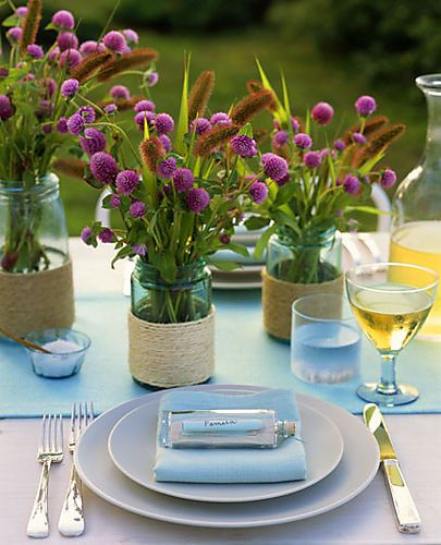 wrap twine around makeup and spice jars or votives. Add Gomphrey (bachelor buttons) and grasses- simple and darling  Patterson Maker