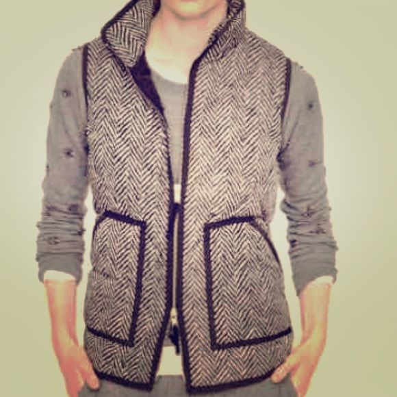 J Crew Herringbone Vest. Authentic. Winter sale! Authentic J Crew vest in medium. Selling coz I need a small instead. J Crew is SOLD OUT  of it and cannot exchange for a smaller size. Must have. Fashion bloggers are all over this fashionable item!  J. Crew Tops Button Down Shirts