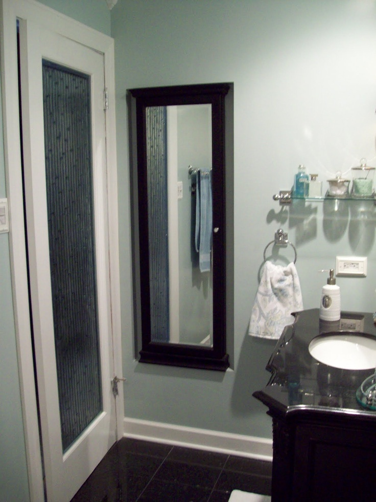 Love my glass bathroom door.  It was a slab only at a builder's warehouse.  By Feather River with bamboo glass.   I painted it white and it is fabulous!  The jewelry cabinet was built into the wall to utilize space behind the door.  It is from Kirkland's.