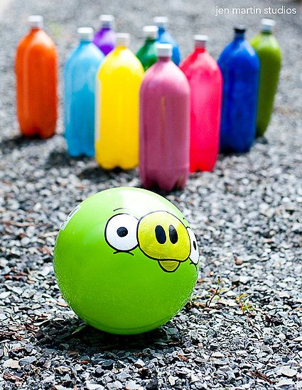 Create a bowling game for your Angry Birds party with a green ball and colored water filled 2-liter bottles.