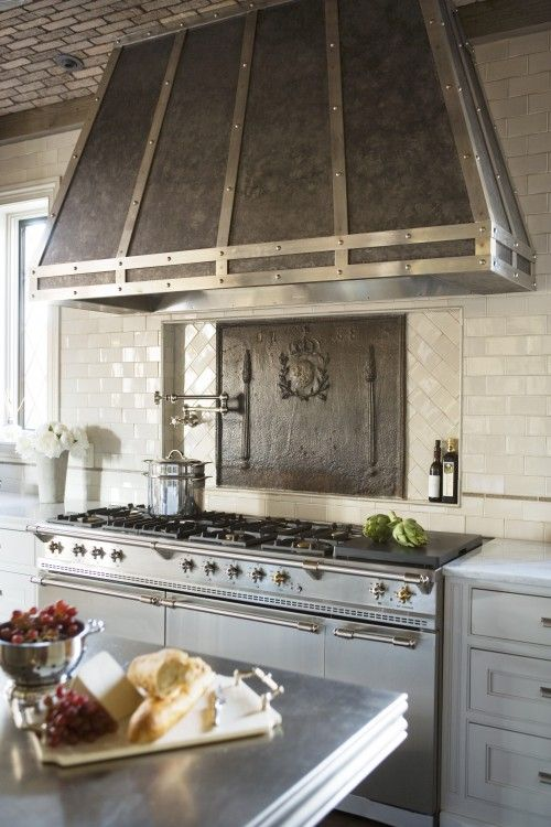 French stainless steel Lacanche range and custom designed zinc and steel range hood by Linda McDougald Design.