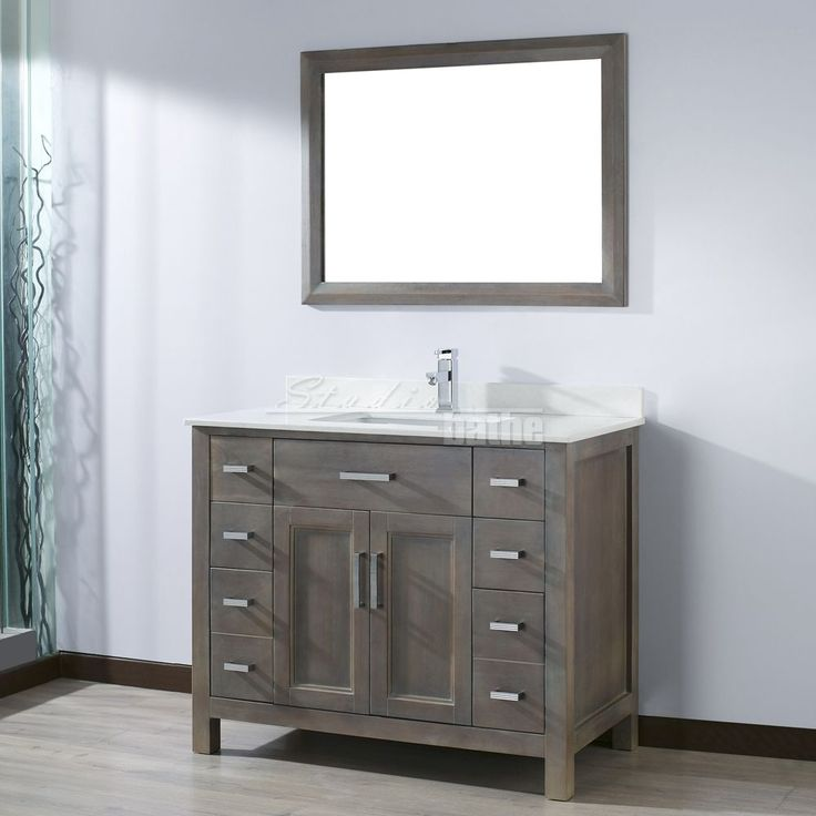 bring a radiant look to your bathroom with studio bathe kelly vanity in french gray with solid surface marble vanity top in carrara white and mirror