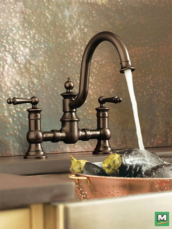 Full of vintage character and farmhouse-fresh style, the Moen® Waterhill® Two-Handle Kitchen Faucet lends provincial elegance to today's more traditional homes. Period-era details, like its gooseneck spout, beautiful bridge design and top finial, this faucet is ingrained with an authentic feel.
