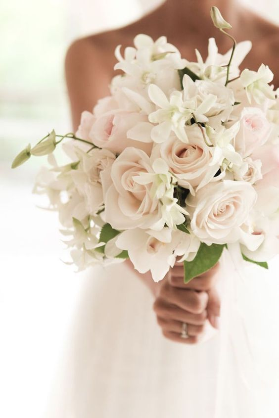 Simple and elegant wedding bouquet. Having a beautiful bouquet is a wedding must have, and to add to those must haves try getting high heel protectors.