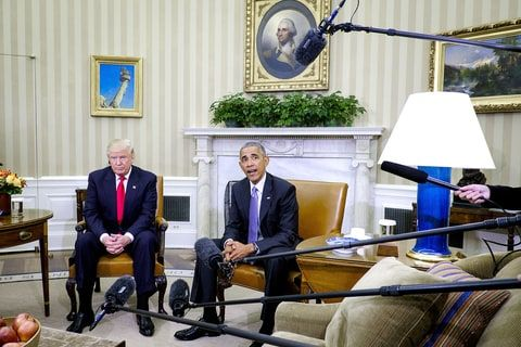 U.S. President Barack Obama (right) speaks as President-elect Donald Trump listens during a news conference in the Oval Office of the White House in Washington, D.C., on Thursday, Nov. 10, 2016.