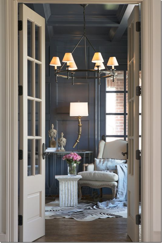 Lovely entrance to the library and such rich colors! Aidan Gray lamp and finials.