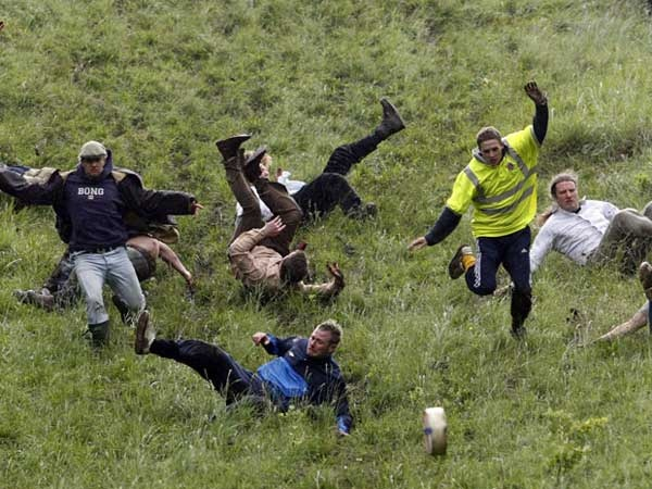 On the Spring Bank Holiday in May a group of barmy Brits assemble on the top of Coopers Hill in Gloucestershire and from the top of the ridiculously steep hill they roll a 7-8lb (4 Kg) round of Double Gloucester cheese and then chase after it — Bonkers! The first person over the finish line (without horrific injuries, cheese related or otherwise) at the bottom of the hill wins the cheese. The cheese wheels can reach speeds of up to 70 mph
