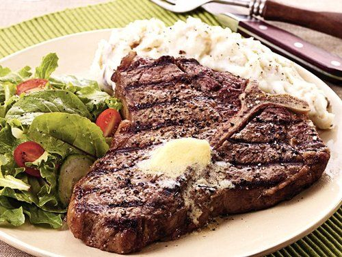 Texas T-Bones Ingredients: 2 beef T-bone steaks, 1 1/2 inches thick and about 1 1/2 pounds each 1 garlic clove, cut in half 2 teaspoons black peppercorns, crushed 1/4 cup butter or margarine,...