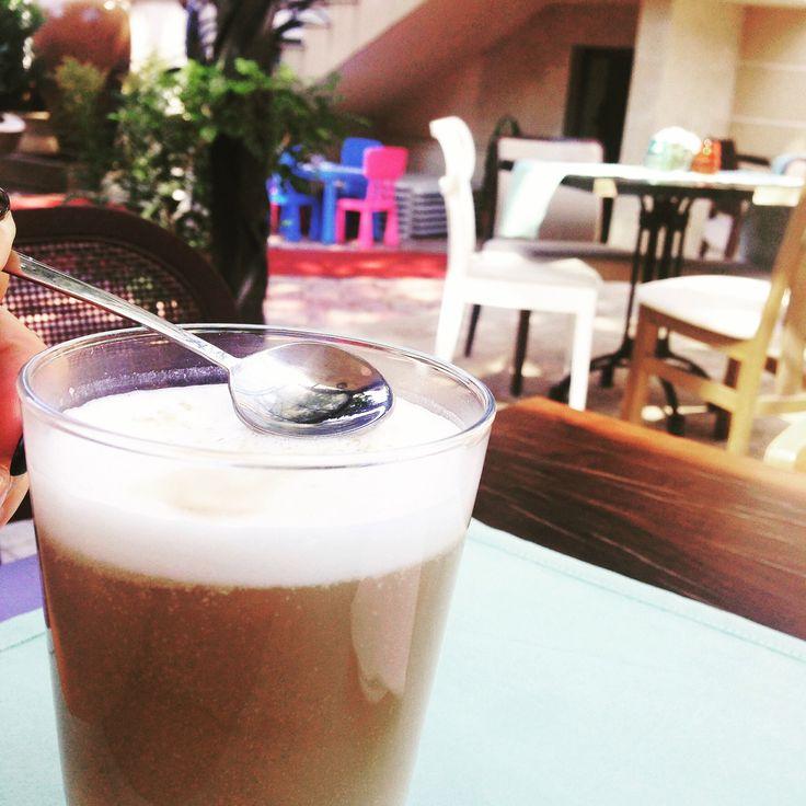 Still summer in september, enjoying a cafe latte