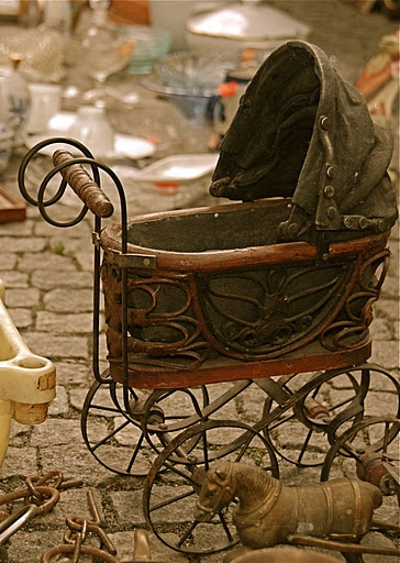 pram not antique, made in the 70s and 1980s in the Philippines. repro co also made 3 wheel horses.