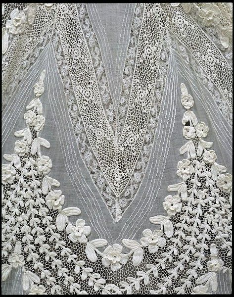 Closeup on day dress, c. 1904-08. If you don't see the pure awesomeness of this, allow me to explain: Every trim here is hand made. Someone, about a century ago, sat down, plotted this, bought the materials and built it, forming minute stitches one by one. The lace was knotted thread by thread. The embroidery stitch by stitch. each pintuck, folded and stitched down by hand. Yards and yards of work. This humbles me.