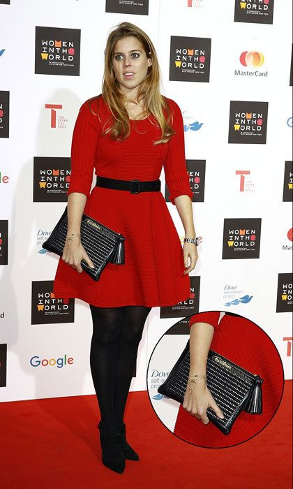 "Princess Beatrice accessorized her vibrant red dress at London's 2015 Women in the World with a black clutch embellished with her name ""Beatrice."""