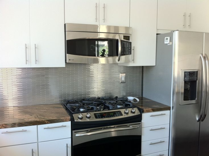 stainless backsplash stainless steel tiles white kitchen cabinets