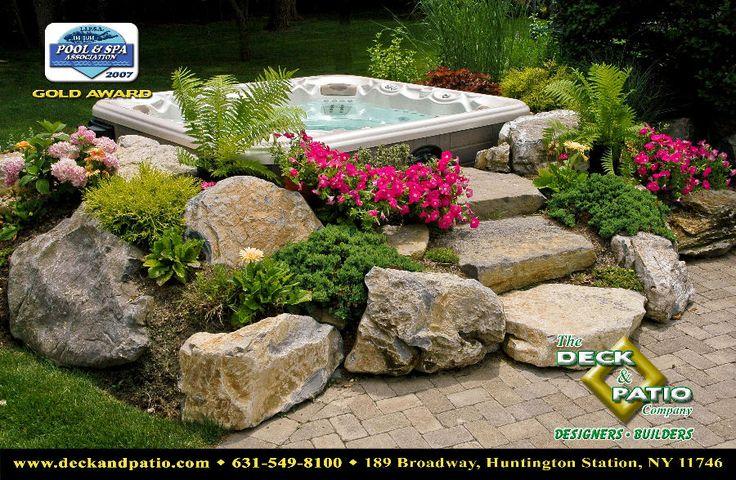 rock garden to hide above ground hot tub