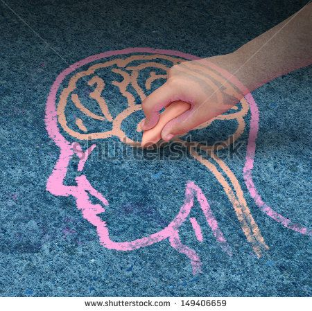 Children education concept  and school learning development with the hand of a child drawing a human head and brain with chalk on a cement floor as a symbol of mental health issues in youth. - stock photo
