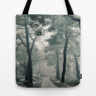 Through the foggy forest Tote Bag by Guido Montañés - $22.00