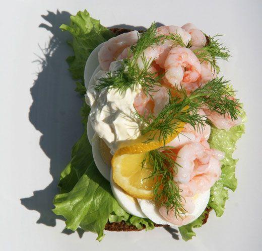 Danish open sandwich Smorrebrod. Shrimp, eggs, mayonnaise, lettuce and dill