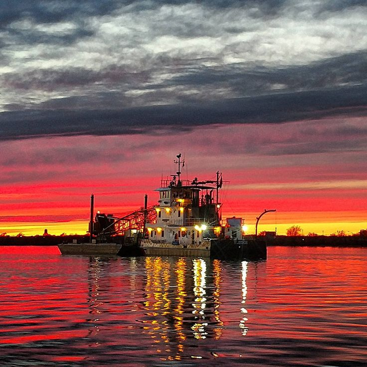 The crew of the Coast Guard Cutter Sledge, a 75-foot Inland Construction Tenders  based out of Baltimore, Maryland, finish a day of aids to navigation work on the Delaware River near Philadelphia, April 19, 2017.   Coast Guard photograph by Petty Officer 2nd Class Daniel Scott.