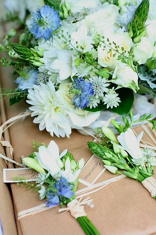 White Chrysanthemums, White Astrantia, White Freesia, Cream Spray Roses, Blue Nigella, Star Of Bethlehem Wedding Bouquet