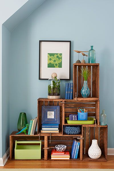 Arrange several inexpensive wood crates into a shelving unit, then give them a…