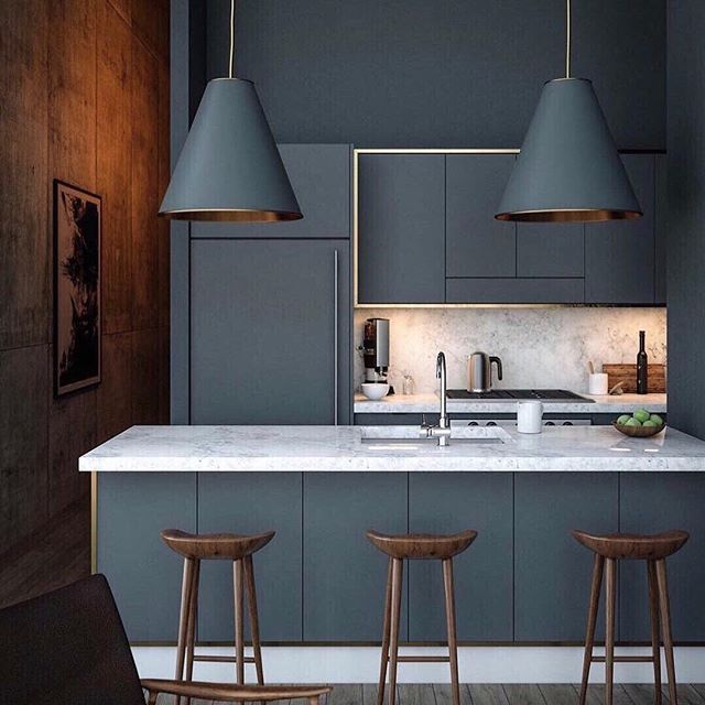 SUNDAY INSPO// Sometimes its best to just keep it simple. Dont you love how these pendant lights blend seemlessly in this stunning dark moody kitchen?  #kitchenlighting #lumisonlighting #brightideas  @harpersbazaarus via @fawninteriorsstudio