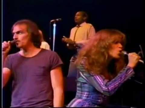 "James Taylor and Carly Simon singing ""Mockingbird."""