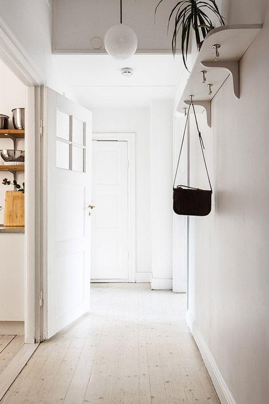 entrance shelf w/ hooks white hallway in fantastic frank styled rental / sfgirlbybay