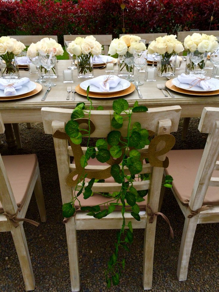 White theme outdoor garden wedding. Dinning table with white roses and gold accents.