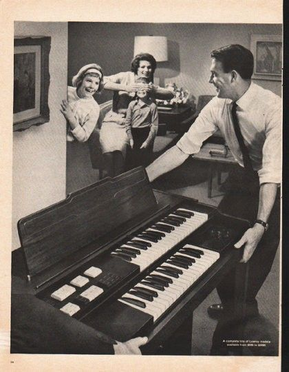 "1961 LOWREY ORGAN vintage magazine advertisement ""Lowrey Starlet"" ~ Enter! The Lowrey Starlet - Exclusive! A complete 2-keyboard organ with percussion -- at the lowest price ever! ... play carols on Christmas morning! ~"