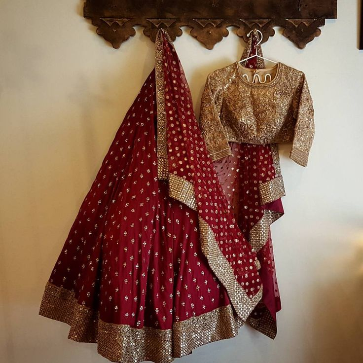 Lovely maroon lehenga and gold designer blouse with long sleeves a beautiful combination from French curve by Anjali Sharma. 03 July 2017