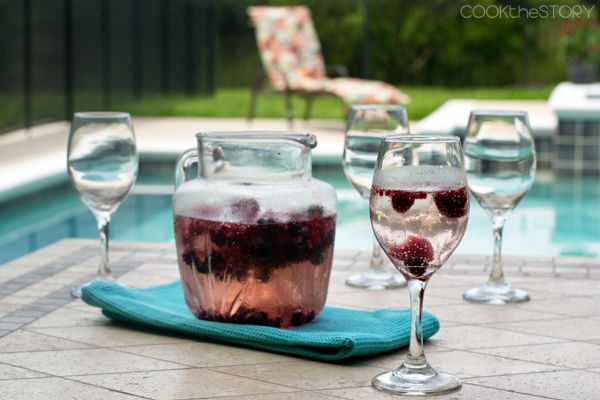 This quick homemade berry wine cooler is really easy to make and perfect for summer barbecues. It uses frozen berries which help cool the drink and flavor.